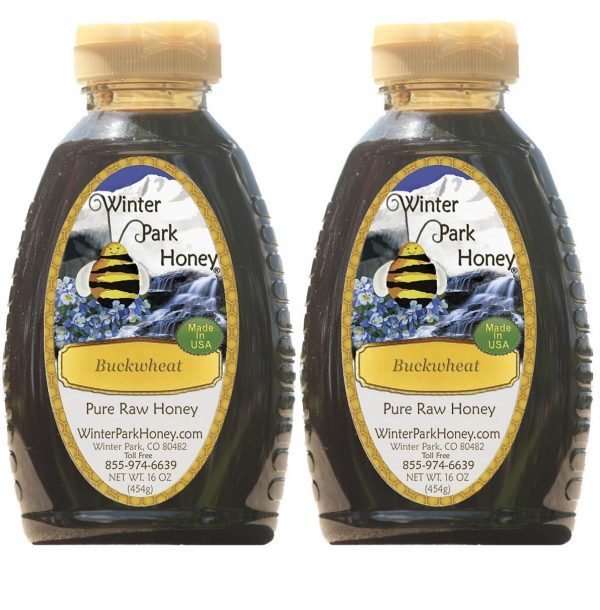 w bottles of buckwheat honey