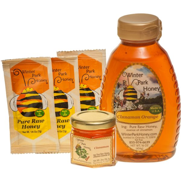 Cinnamon honey in glass jar, squeeze container and single serve packets