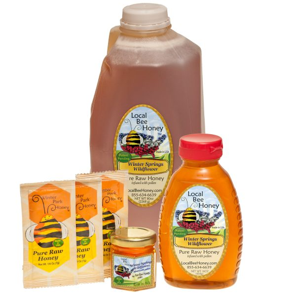 Pure raw Winter Springs Florida Wildflower honey in several different sized containers.