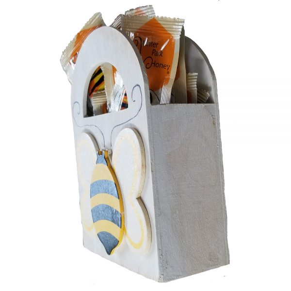 side view of hand painted bee box with honey packets inside
