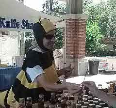 dan dressed in bee suit selling honey at a market